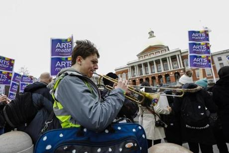 Musicians played their instruments across the street from the State House on Arts Matter Advocacy Day.